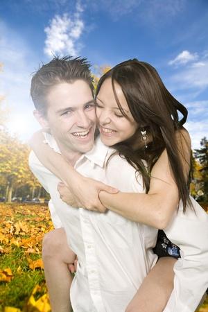 medium shot: happy couple medium shot at fall time Stock Photo