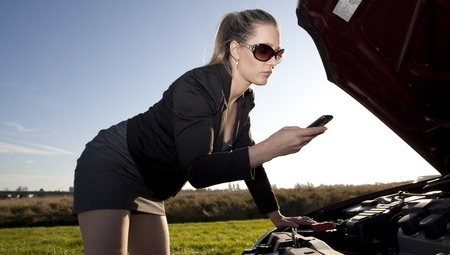 girl having engine trouble on the side of the road Фото со стока