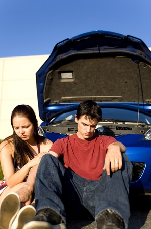 couple sitting down after car break down