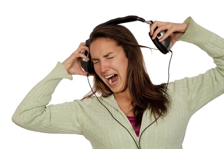 woman listening loud music over white background wearing green t-shirt