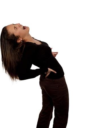 Mujer padece dolor de espalda sobre fondo blanco con camiseta negra Foto de archivo - 10374620