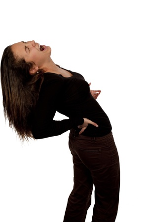 back ache: woman suffering from back pain over white background with black t-shirt Stock Photo
