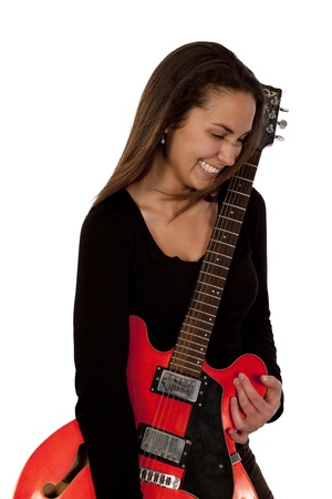 Woman holding red electric guitar over white background photo