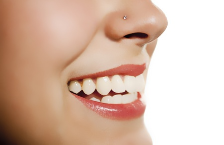 noses: woman mouth smiling showing tooth over white background Stock Photo