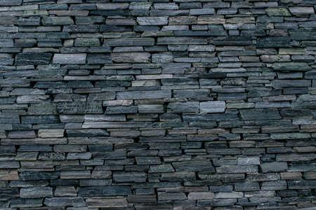 decorative wall: Brick wall made of stone. Great pattern and good craftsmanship Stock Photo