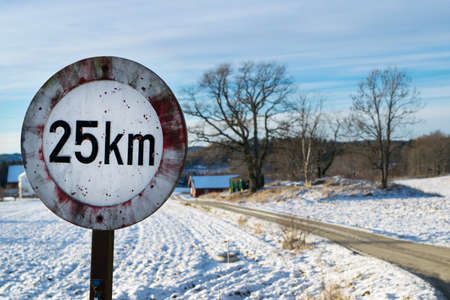 speed limit sign: Speed Limit Sign that are shot with shotgun. Rural areas in Norway Stock Photo
