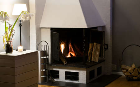 burning time: Fireplace inside home burning wood. For heating and recreational use, or simply romantic snuggle time Stock Photo