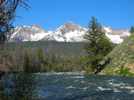 Salmon River and Sawtooth Mountains in Sawtooth National Recreation Area in Idaho Stock Photo