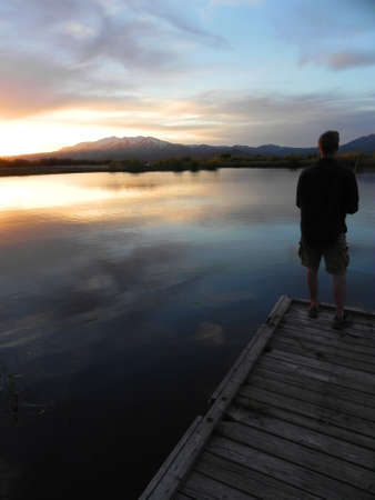 sawtooth national forest: Fishing at sunset over Soldier Mountains and Kid Pond in Fairfield, Idaho