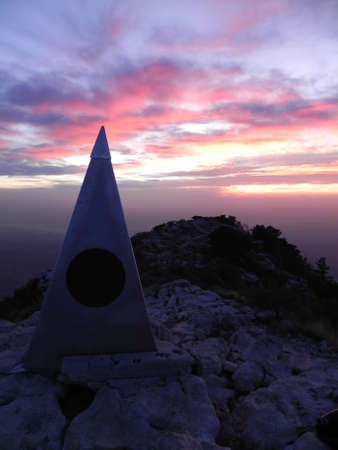 Guadalupe Peak high point monument at sunset in Guadalupe Mountains National Park in Texas photo