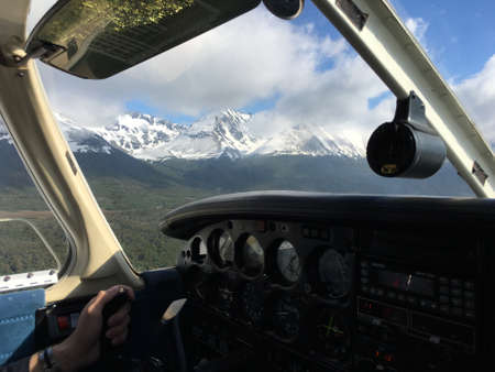 piper: Flying in a Piper airplane above Ushuaia, Argentina Stock Photo