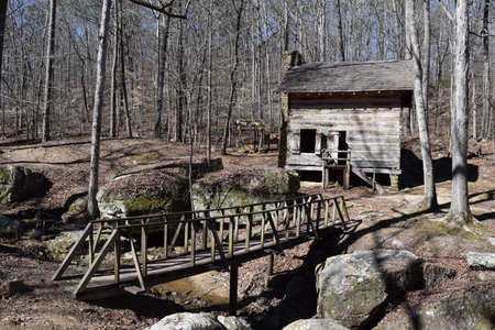 Pioneer Cabin and footbridge in Tishomingo State Park Mississippi Stock Photo