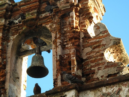 old brick wall: old bell and pigeons Stock Photo