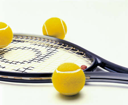 tennis racket: Photo illustrated a racket and tennis balls objects equipment sports tennis