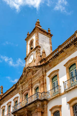 conspiracy: Front view of the facade of the Conspiracy Museum with its tower and clock in the Ouro Preto city