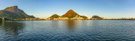 redeemer: Panoramic image with the Christ Redeemer and Rodrigo de Freitas lagoon with vegetation and constructions around Stock Photo