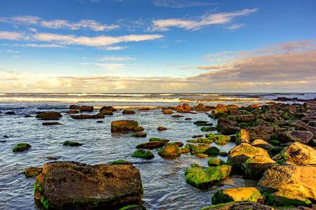 cal: Meeting between the rocks and the sea in Cal beach. Torres city, Rio Grande do Sul, bordering Santa Catarina Stock Photo