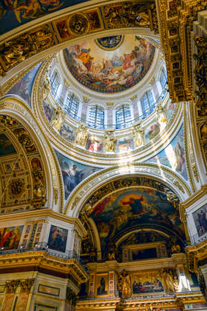 famous paintings: Central dome inside the old and famous St. Isaacs Cathedral with its frescoes, columns and paintings in St Petersburg in Russia Editorial