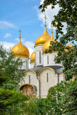 iron curtain: Dormition Cathedral view through the trees of the Kremlin gardens