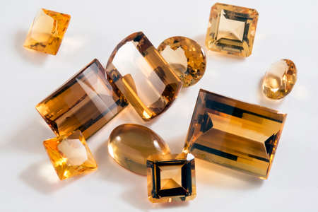 Several yellow citrine stones with different types of cutting Stock Photo