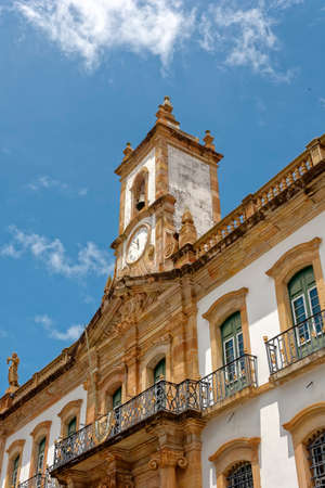 law of brazil: Old clock on the central tower where the bell is also the Conspiracy Museum, the former Chamber of house and jail in the city of Ouro Preto Editorial
