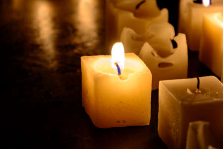 erased: Candles, erased and melted with dark background Stock Photo