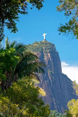 Cristo Redentor seen through the tropical vegetation of Rio de Janeiro