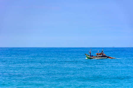 Fishing boat sailing in the waters of the Rio de Janeiro sea Stock Photo