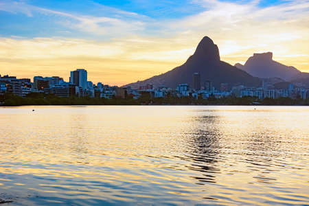 Image of the late afternoon at Lagoa Rodrigo de Freitas in Rio de Janeiro with its mountains, buildings and characteristic outline