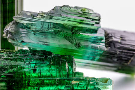 Detail of brazilian green tourmaline crystal with its texture, colors and transparency