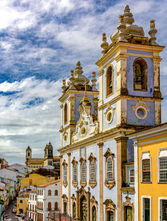 Top Church facade of Our Lady of the Black Rosary in Pelourinho in Salvador. He had the start of works in 1704 and holds an attached cemetery of slaves. Stock Photo