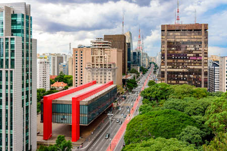 Avenida Paulista, financial center of Sao Paulo and Brazil and the MASP seen from above with its commercial buildings and intense movement of people and cars Imagens