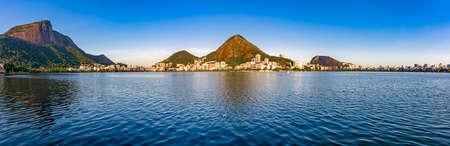 Famous panoramic landscape and skyline of Rio de Janeiro at Rodrigo de Freitas lagoon with Christ Redemer hill