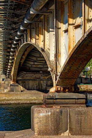 ferrous: Old rusted metal bridge over water