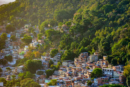 Favela between the vegetation of the slopes of the hills in Copacabana in Rio de Janeiro Stock Photo