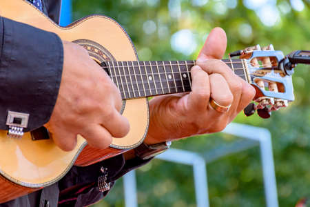 Live musical performance of Brazilian popular music called chorinho with little acoustic guitar with four strings