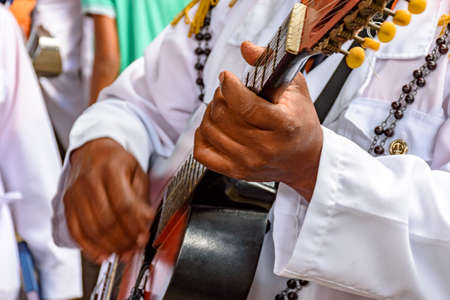 Live musical acoustica guitar performance of Brazilian popular music during popular religious brazilian festival acoustic guitar 写真素材