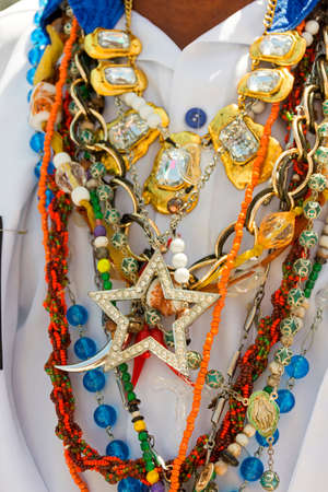 Necklace used by man during traditional religious celebration in Brazil with common symbols the practice of umbanda and candomblé