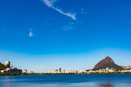 Rodrigo de Freitas lagoon with the buildings of Ipanema and Leblon on city of Rio de Janeiro, Two Brothers hill and Gavea stone