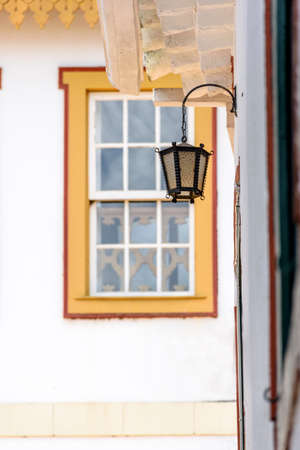 Facade of old houses in colonial architecture and lighting lantern