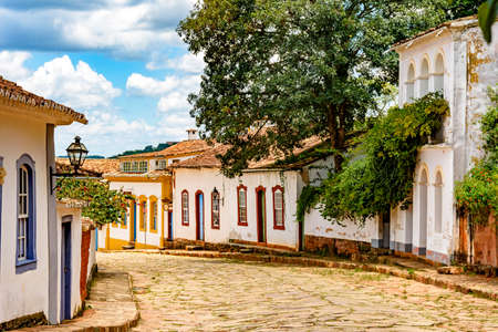 Street with cobblestones and some houses with colonial architecture in the old and historic city of Tiradentes