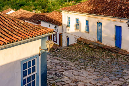 Paving stones made by slaves on the streets with colonial-style houses in the city of Tiradentes built in the 18th century