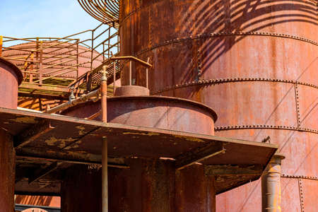 Corroded and rusty gears, tanks and pipes of old machinery for processing abandoned iron ore in Minas Gerais, Brazil