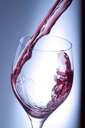 pouring red wine into a glass photo