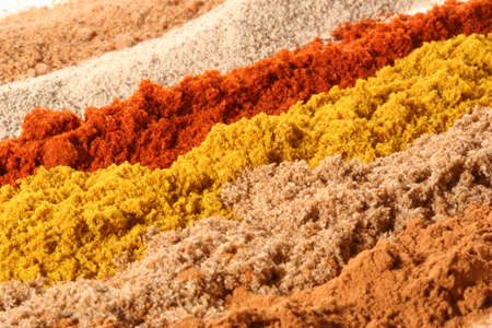 flavouring: from front to back: cinnamon, coriander, curry, paprika, white pepper, nutmeg Stock Photo