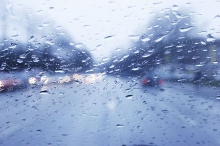Driving on a highway on a gray rainy day.