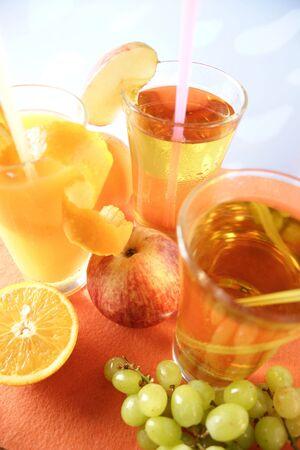 and grape juice: Glass of apple juice, orange juice and grape juice
