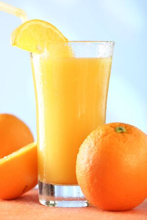 quencher: glass of orange juice with straw Stock Photo