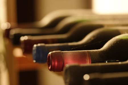 bottlenecks: Bottlenecks in the wineshelf Stock Photo