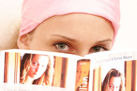fifteen year old: Fifteen year old girl is reading a book Stock Photo